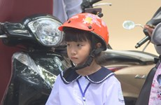 Police take measures to increase helmet-wearing rate among children