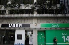 Grab, Uber fined nearly 10 million USD in Singapore