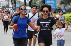 More than 10,000 people join Fund Run for Charity in HCM City