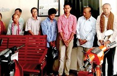 Cambodia charges 8 people with organising combat group, trafficking firearms