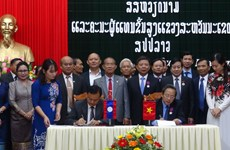 Quang Binh, Lao locality promote cooperation, exchange