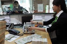 Reference exchange rate drops by another 2 VND