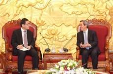 Party official receives Japanese professor, ambassador