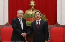 Party economic commission head receives Japanese SMBC leader