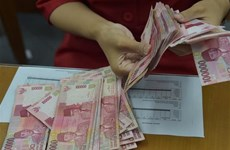 Pressure on rupiah not yet over in short term: Minister
