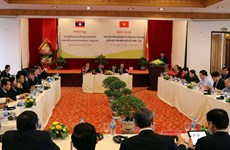 Vietnamese, Lao border localities share experience in religious affairs