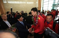 Vietnam's national football team welcomed home