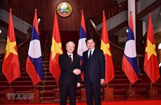 Top Vietnamese leader seeks stronger relations with Laos