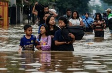 Indonesian floods kill two, force hundreds to evacuate