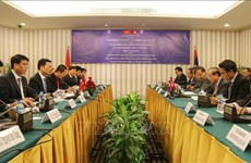 Vietnamese, Lao information ministers discuss enhancing ties