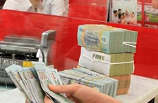 Reference exchange rate down by 5 VND