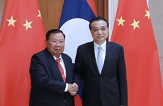 China willing to step up cooperation with Laos