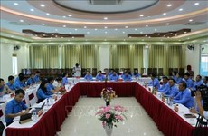 Son La, Lao provinces exchange experience in trade union work
