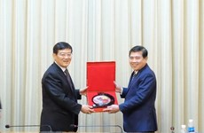 HCM City leader hosts Chinese industry, commerce delegation