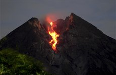 Volcanoes in Indonesia spew incandescent lava, ash column