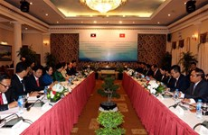 HCM City, Vientiane leaders share Party work experience