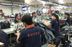 High-level Swiss delegation visits garment factory in Dong Nai