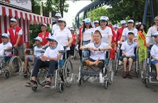 HCM City: Thousands walk for AO victims, people with disabilities