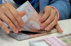 Four major Thai banks cut loan interest rates to spur economy
