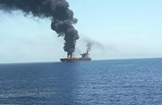 Indonesia looks for missing victims of burning ship
