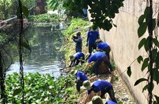 Green Summer volunteers clean up canals, build roads and houses