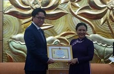 Friendship insignia presented to Cambodian Ambassador