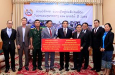 Vietnamese community in Laos donate for flood victims