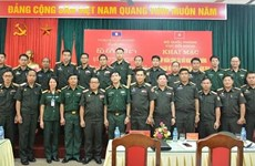 Vietnam helps Laos train personnel on defence external relations