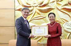 Lao Ambassador awarded with Vietnam's friendship medal