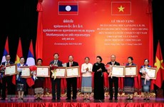 Friendship orders presented to Lao NA collectives, individuals