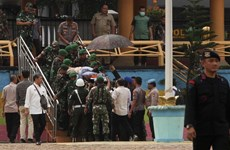 Indonesia arrests 22 terror suspects after minister attacked