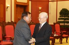 Party leader, President receives Lao counterpart