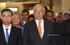 Former Malaysian PM ordered to enter defence on seven charges