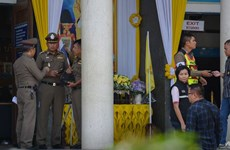 Thai clerk charged with murder after shooting gunman in court