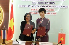 VNA, PRD step up cooperation in news exchange