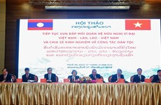 Vietnam – Laos conference to share experiences in ethnic work