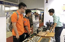 Int'l machinery, supporting industry fairs open in HCM City