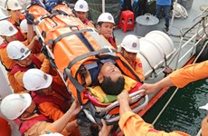 Indonesian comatose sailor brought ashore for treatment