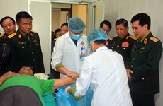 Vietnamese, Lao armies provide health care for 11,660 people