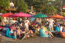 Tourists flock to Bali to celebrate New Year's Eve