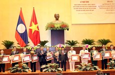 Laos honours Vietnam's National Assembly organisations, individuals