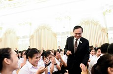 Thai PM asks young people to help preserve national institutions