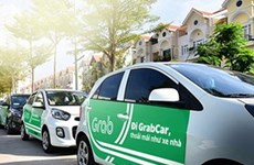 Grab cars must have TAXI light-box or logo