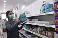 Thailand tightens control of face mask price