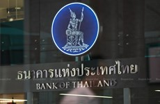 Thailand's central bank cuts key interest rate to record low
