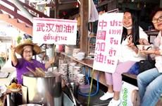 Damnoen Saduak Floating Market merchants send support to China