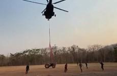 Thai army airlifts heavy firefighting machinery to Phu Kradueng