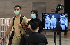 Singapore charges foreigners with COVID-19 for treatment