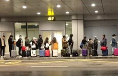 Passengers have samples taken for COVID-19 testing right at airports