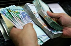 Malaysia widens fiscal deficit target